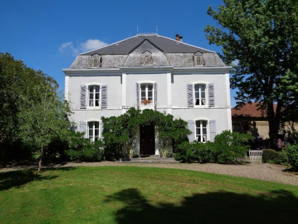This magnificent Maison de Maitre is tucked away within its own grounds of just over ½ a hectare of mature trees, shrubs and lawns. Conveniently situated close to the centre of a small market town with all the necessary amenities within easy walking distance.