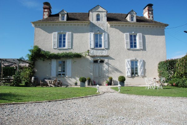 This handsome Maison de Ma�tre is located in a quiet village 20 minutes east of the beautiful historic city of Pau. The gardens are private with views of the Pyrenees mountains and neighbouring farmland to the rear.