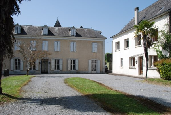 A large ensemble of buildings ideally suited to create a chambres d'hôtes and gîte business.  Situated within walking distance of the historic riverside town of Oloron Ste Marie. Impressive views of the Pyrenees Mountains.