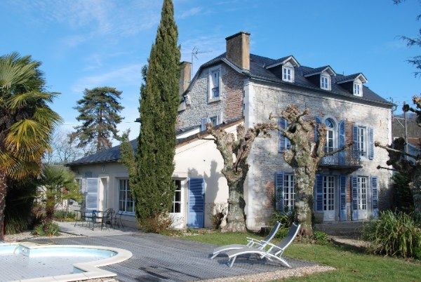 Situated on the edge of a popular well-served village, this delightful stone house offers charming period living, with a private rear garden & pool and the convenience of shops and restaurants within walking distance.  Located 20 minutes south of the historic city of Pau, with easy access into the P
