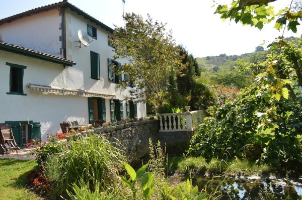 This 18C House with its adjoining 14C former Water Mill and independant guest apartment, is situated in the Arberou Valley, 30 minutes from the holiday resort of Biarritz.  Due to its proximity to the coast, the current owners successfully let the holiday apartment and two B&B rooms, which provides