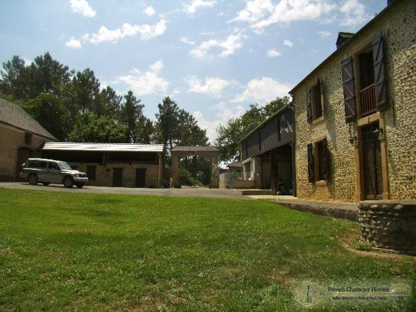 The Courtyard, formed by the Farmhouse, Its open Hangar, the Former Pig Sty and the Barns.