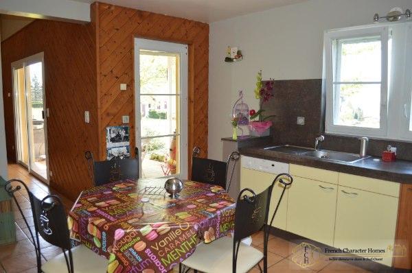 The Kitchen leading to the Salon, Terrace & Garden