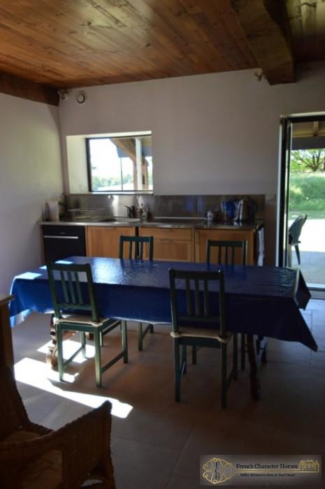 The kitchen with Access to the Terrace