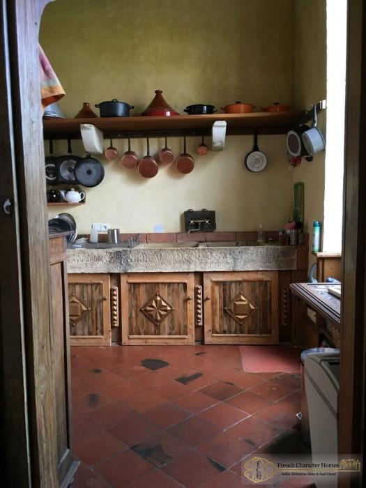 Bright Copper Pans and Aged Terracotta Floors