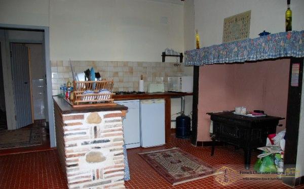 The Gîte : Kitchen Fireplace