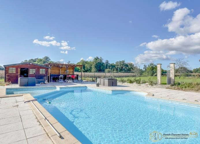 The Heated Saltwater Pool with Pool House and Summer Bar